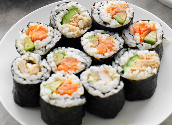 Assorted sushi rolls with soy sauce and wasabi thumbnail