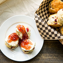 Petit scones with jam and cream thumbnail