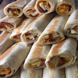 Breakfast wrap with bacon, cheese and egg thumbnail