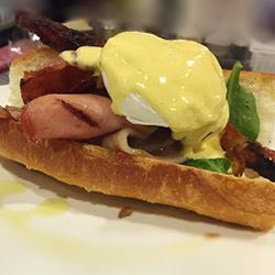 Poached eggs with bacon breakfast baguette thumbnail
