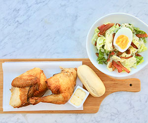 BBQ chicken with caesar salad and fresh rolls thumbnail