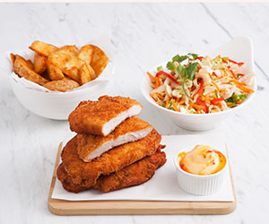 Chicken schnitzel with Asian slaw and wedges thumbnail