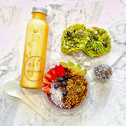 Smoothie cup, bliss ball, alkaline water, mini bagel and salad thumbnail