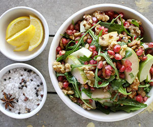 Pear, roquette, pomegranate and walnuts thumbnail